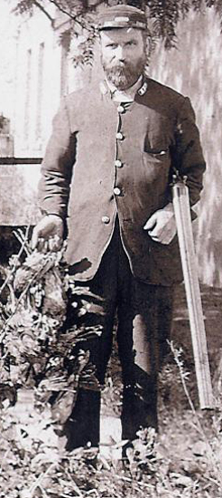Daniel Ray, n.d., in his railways uniform, with his hunting gun